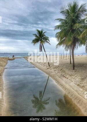 Tranquility at Copacabana beach on a cloudy day. - Stock Photo