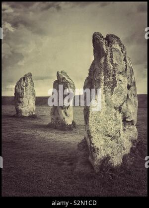 Three large upright Standing Stones form part of the SE Sector of the famous Stone Circles at Avebury in Wiltshire, England. This is the largest Megalithic Stone Circle in the World & a UNESCO site. - Stock Photo
