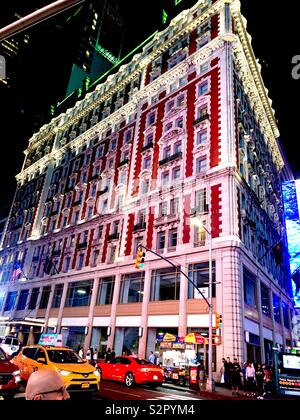 Knickerbocker Hotel 42nd Street New York City near Times Square with traffic at night - Stock Photo