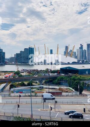 Greenwich, UK - 5 July 2019: The O2 Arena seen from across the River Thames on the Emirates Air Line cable car ride. - Stock Photo