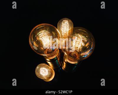Illuminated vintage style lightbulbs - Stock Photo