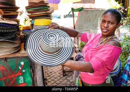 Cartagena Colombia Old Walled City Center centre Centro Hispanic resident residents woman shopping sombrero vueltiao traditional hat cultural symbol v - Stock Photo