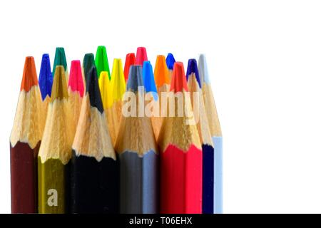 Crayons and pastels lined up. Close up of an assortment colored pencils tips on white background. Background of colorful pencils. Closeup. Selected - Stock Photo