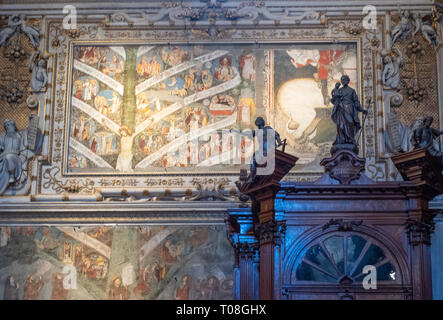 Italy, Bergamo, Wooden sculptures and paintings of the side entrance of the S- Maria Maggiore Basilica - Stock Photo