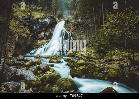 Beautiful view of famous Gollinger Wasserfall with mossy rocks and green trees on a moody in springtime, Golling, Salzburger Land, Austria - Stock Photo