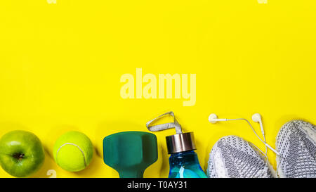Flat lay composition with fitness equipment on yellow background. - Stock Photo