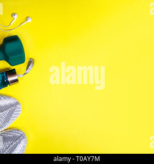 Flat lay composition with fitness equipment on yellow color background. - Stock Photo