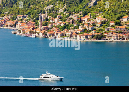 Aerial view of motor boat that run along the water surface leaving a white trail. Montenegro - Stock Photo
