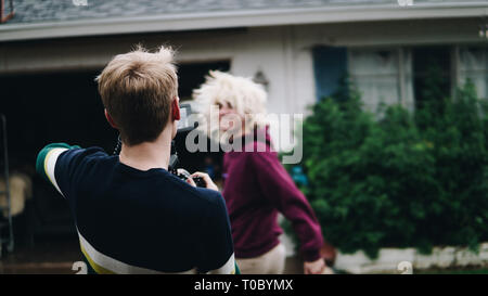 A crazy photo shoot with a funny model. - Stock Photo