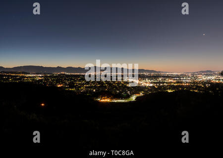 Before dawn view of the San Fernando Valley with San Gabriel Mountains in background in Los Angeles, California. - Stock Photo