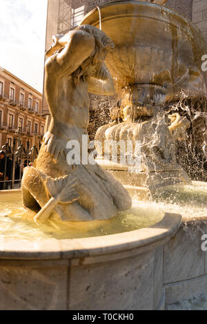 Amenano fountain and marble sculptures over the underground river running under Catania city centre in Sicily, Italy. - Stock Photo