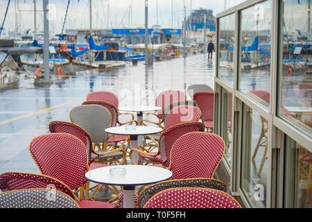Empty seafront restaurant in Limassol marina. Cyprus - Stock Photo