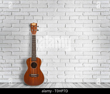 Ukulele guitar on a white wall background. Concept of travel and lifestyle. - Stock Photo