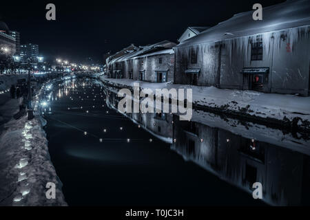 The famous canal in Otaru, Hokkaido, Japan. Taken in winter, this shot shows the snow and ice surrounding this famous location. - Stock Photo
