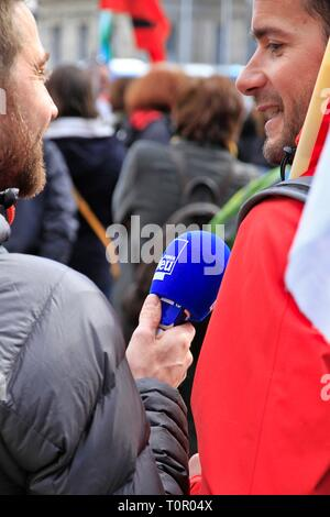 Illustration of media during a trade union demonstration, including radio France Bleu Isere during an interview with a protester, and a cameraman. - Stock Photo