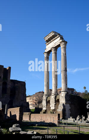 Three Columns of the Ancient Roman Temple of Castor and Pollux (495BC), a Dioscuri Temple in the Roman Forum Rome Italy - Stock Photo