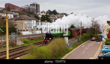 Old Leigh, Essex, UK. 23rd Mar 2019. Reserved steam locomotive 61306 'Mayflower' hurtles through Old Leigh in Essex early this morning en-route to the Bluebell railway in East Sussex. from Southend-on-Sea. 'Mayflower' is one of only 2 LNER Class B1 locomotives preserved and it only returned to mainline running last year. Credit: Timothy Smith/Alamy Live News - Stock Photo