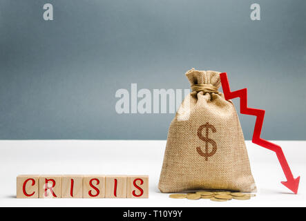 Wooden blocks with the word Crisis and money bag. The concept of financial and economic crisis. capital outflow. sabotage of the economy. bankruptcy.  - Stock Photo