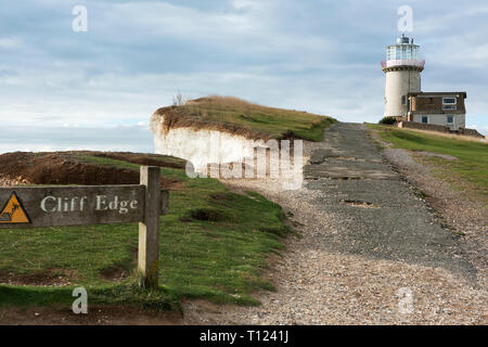 The erosion of the chalk cliffs once again threatens the Belle Tout lighthouse near Beachy Head on the Sussex coast. - Stock Photo