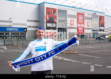 Cardiff, UK. 23rd Mar, 2019. A Slovakian Fan poses outside the Grandstand ahead of Wales v Slovakia UEFA Euro 2020 Qualifier at the Cardiff City Stadium, Credit: Lewis Mitchell/Alamy Live News - Stock Photo