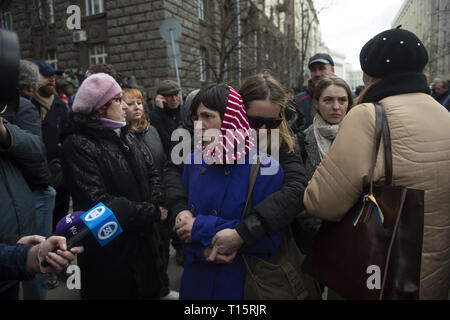 Kyiv, Kyiv Oblast, Ukraine. 23rd Mar, 2019. A woman who lost a family member in the ongoing Donbas War in Ukraine's East, seen speaking to camera crews during the demonstration. Protesters gathered in Maidan Square then marched to the Presidential Administration building to call on President Petro Poroshenko to bring corrupt governmental officials to justice. With the Ukrainian Elections being held at the end of March the political tensions run very high. Credit: Matthew Hatcher/SOPA Images/ZUMA Wire/Alamy Live News - Stock Photo