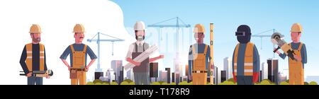 construction workers team industrial technicians builders group over city construction site tower cranes building residential buildings cityscape - Stock Photo