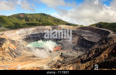 Acid lake in the crater of Poas Volcano in Costa Rica - Stock Photo