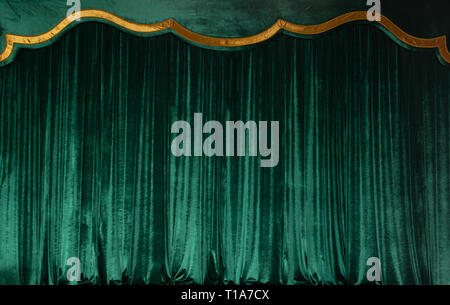 Green curtain of luxurious velvet on the theater stage. Copy space. The concept of music and theatrical art. - Stock Photo