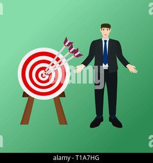 Businessman standing near success archery arrow to center target - Stock Photo