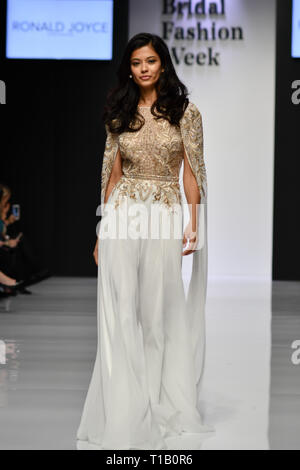 London, UK. 25th March, 2019. Exhibitor and Model showcases at London Bridal Fashion Week at London Excel on 25 March 2019, UK. Credit: Picture Capital/Alamy Live News - Stock Photo