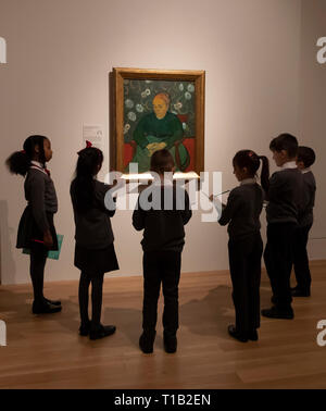 London, UK. 25th Mar, 2019. School children study the painting by artist Vincent van Gogh during the preview for the Van Gogh and Britain exhibition at Tate Britain in London, Britain on March 25, 2019. The exhibition will be open from March 27 to August 11. Credit: Han Yan/Xinhua/Alamy Live News - Stock Photo