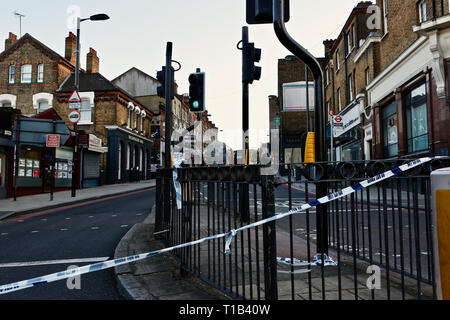 Forest Hill, South East London. UK. 25th March 2019. Police cordon off Dartmouth Road the scene of a stabbing; as schoolboy  fights for his life after being stabbed on Dartmouth - south east London. Credit: Paul Iwala/Alamy Live News - Stock Photo