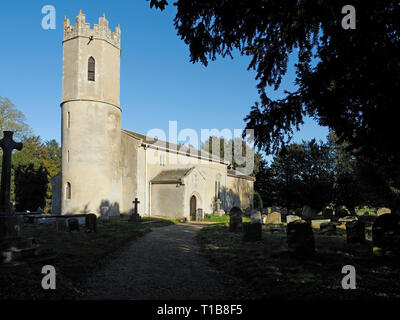 Raveningham church, dedicated to St Andrew, is medieval in origin and has one of the round towers common in Norfolk. - Stock Photo
