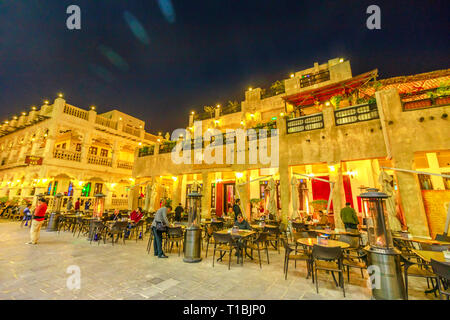 Doha, Qatar - February 17, 2019: historic buildings with traditional restaurants at Souq Waqif in central street, the old market in Doha, popular - Stock Photo