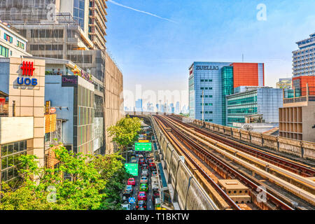 this unique image shows the skytrain bts trail in bangkok thailand and you can see the skyline of the city in the background - Stock Photo