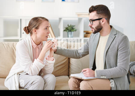 Consultation on couch - Stock Photo