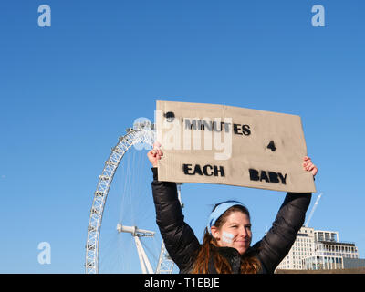 London, UK. 25th March, 2019. A group of young people, on a March for Life, demonstrate on Parliament Square, London, UK and walk to Westminster Bridge for a 9 minutes protest to highlight that since David Steel's Abortion Act 1967, 9 million abortions have been performed in the UK. Credit: Joe Kuis / Alamy Live News - Stock Photo