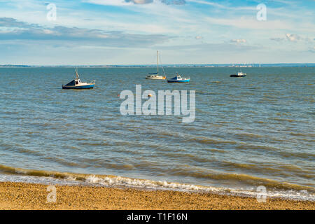 Boats on the shore of the River Thames, seen in Southend-on-Sea, Essex, England, UK - Stock Photo