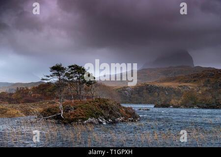 Suilven in cloud over a stormy Loch Druim Suardalain, Glen Canisp, Assynt, Sutherland, Scotland, UK - Stock Photo