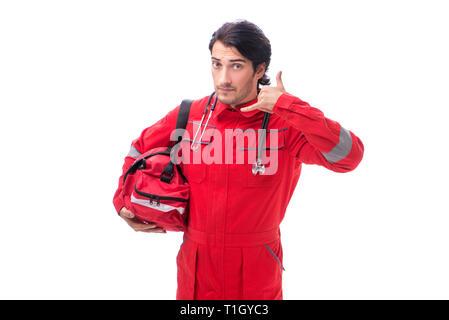 Young paramedic in red uniform isolated on white - Stock Photo