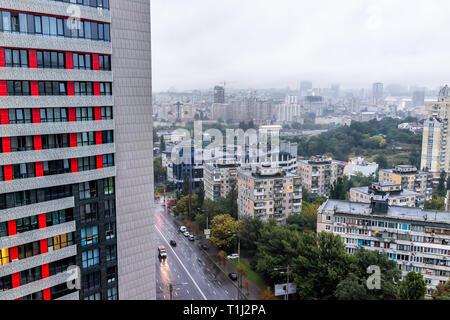 Kyiv, Ukraine - September 9, 2018: gloomy cityscape skyline of Kiev by Vokzalna rail station metro area during dark rainy cloudy and overcast day and  - Stock Photo