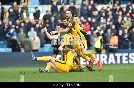 Brighton's players celebrate winning the penalty shoot out during the FA Cup quarter final match between Millwall and Brighton & Hove Albion at The Den London . 17 March 2019 Editorial use only. No merchandising. For Football images FA and Premier League restrictions apply inc. no internet/mobile usage without FAPL license - for details contact Football Dataco - Stock Photo