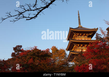 Autumn sunset hits the three tiered Pagdoa, Kiyomizu-dera Buddhist temple, Kyoto. - Stock Photo