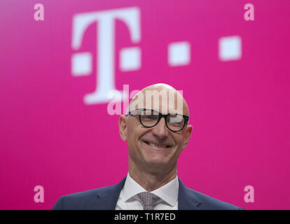 Bonn, Germany. 28th Mar, 2019. Timotheus Höttges, Chairman of the Board of Management of Deutsche Telekom, will attend the Annual Shareholders' Meeting. Deutsche Telekom's shareholders met for the shareholders' meeting. Credit: Oliver Berg/dpa/Alamy Live News - Stock Photo