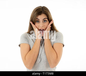 Beautiful young blond woman with happy face pointing and making surprised gestures and looking at something shocking and good. Human facial expression - Stock Photo