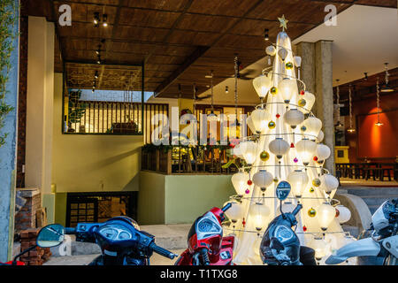 Oriental style Christmas tree made of white Chinese lanterns in Hanoi, Vietnam. - Stock Photo