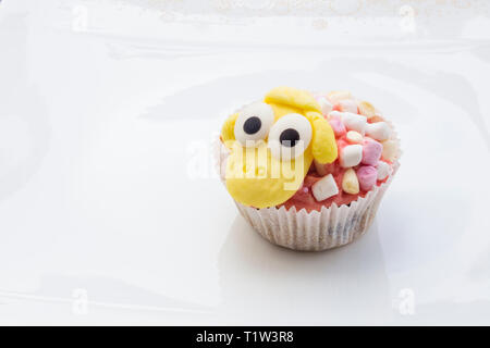 Detail of funny Eastern muffins with sheep character in white background. - Stock Photo