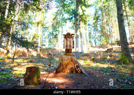 Wooden mythical dwarf is the guardian of the forrest. - Stock Photo