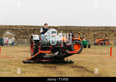 Plougonvelin, France - July 29, 2018: Traditional agriculture festival with exhibition of old tractors in Point Saint-Mathieu - Stock Photo