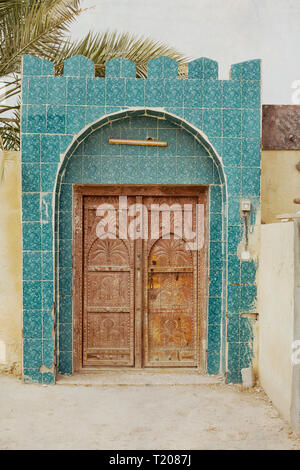 Front of a house in a village in Oman. Decorated with colorful glazed tiles. - Stock Photo